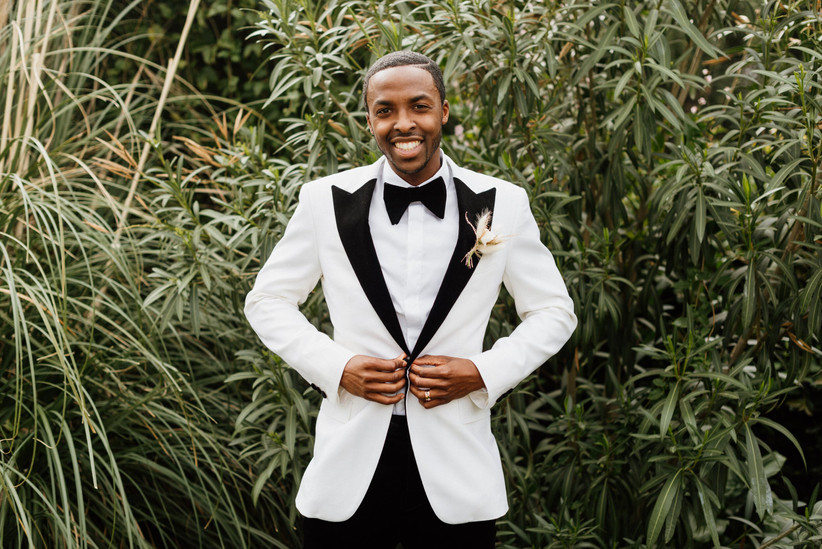 formal wedding boutonniere with white tuxedo
