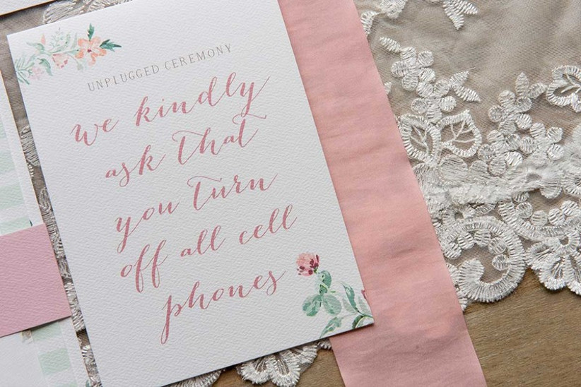 unplugged wedding ceremony program with floral motifs