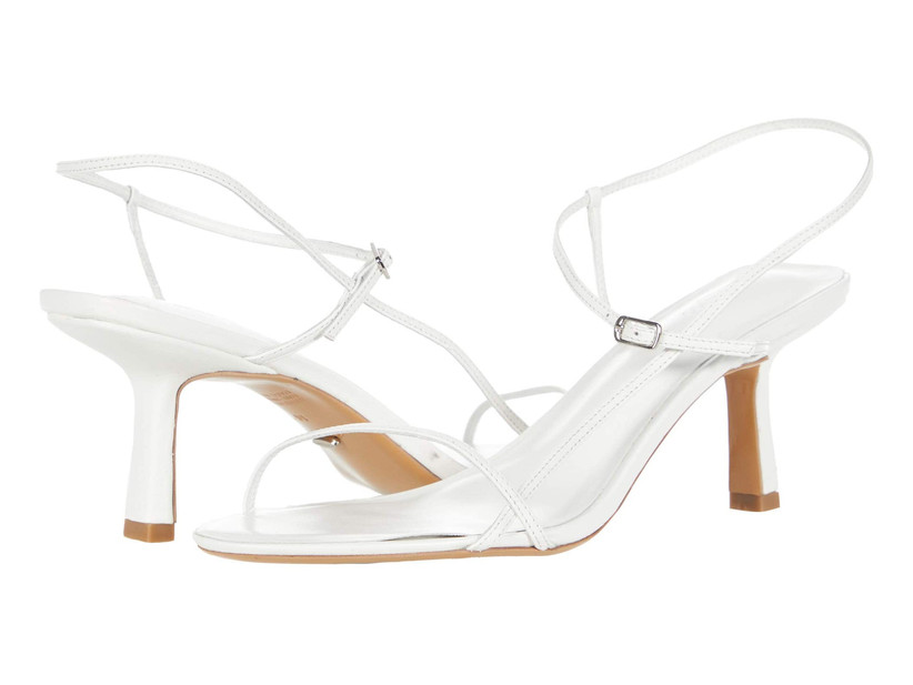 simple white low high heels with strappy design and minimal buckles