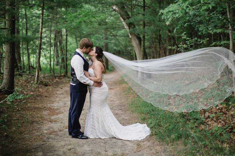wedding groom and bride with flowing veil