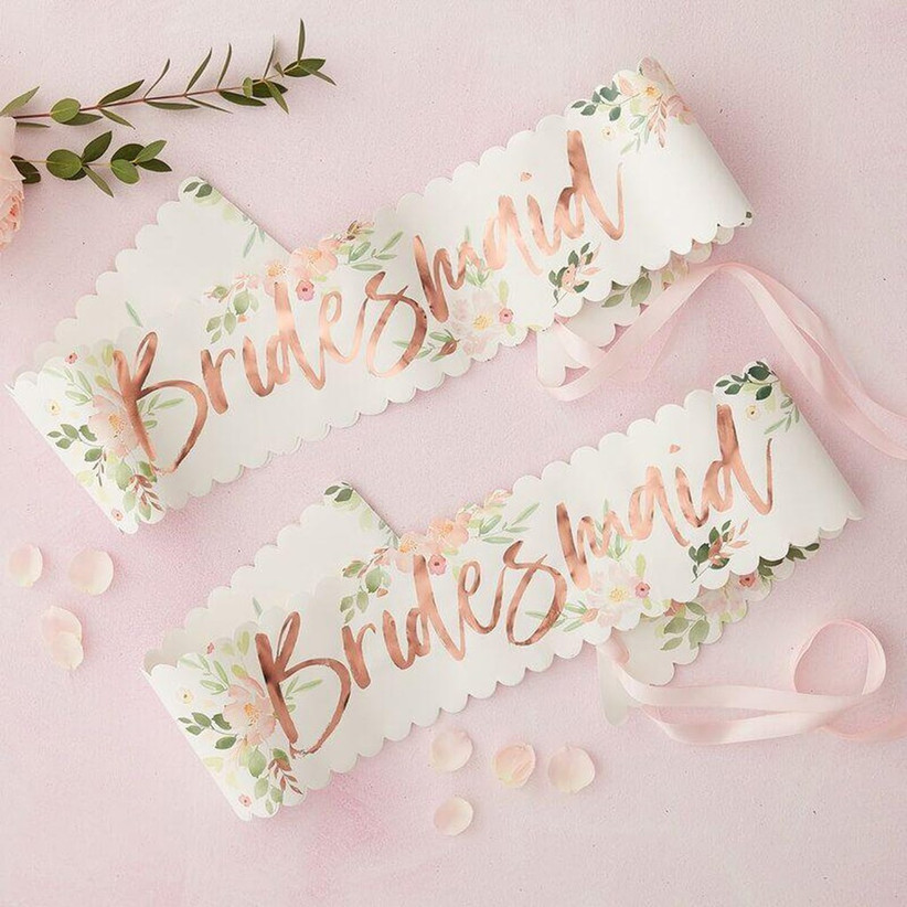 floral print bridesmaid bachelorette party sashes with pink ribbons and