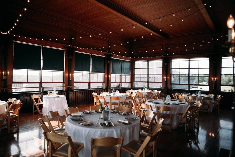indoor rhode island wedding venue rustic cabin-style reception space with string lights
