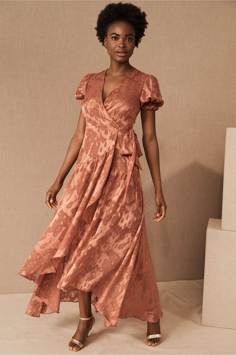 Black model wearing orange satin bridesmaid dress trend wrap-dress with puff sleeves