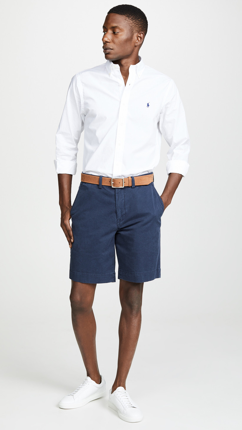 Chino shorts and button-down shirt rehearsal dinner guest outfit
