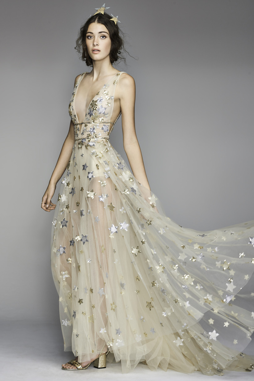 model wearing gold tulle wedding dress adorned with gold and silver sequin stars