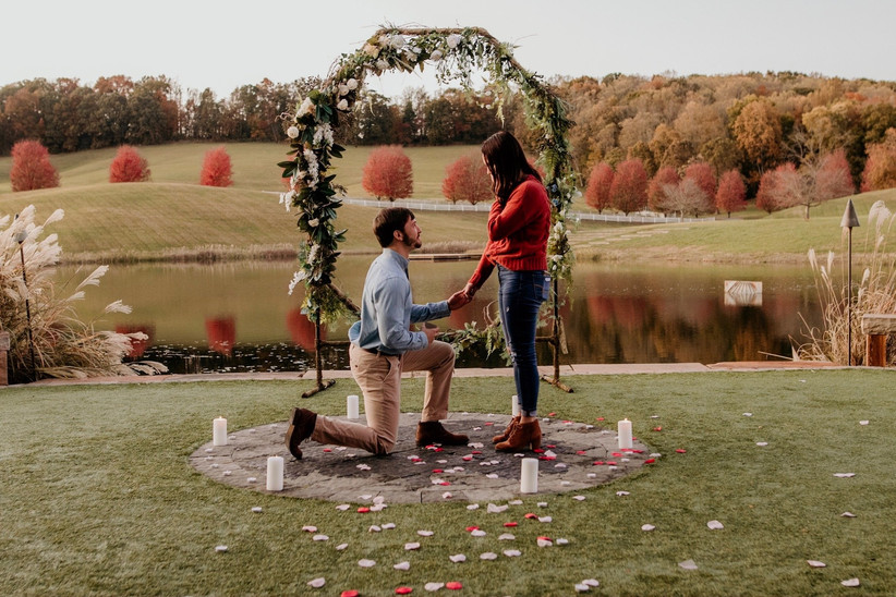 intimate proposal with candles and flower petals