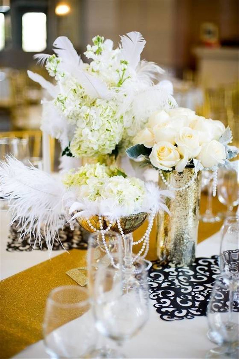 great gatsby wedding theme centerpiece with white feathers and pearl strands