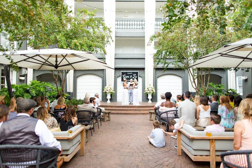 couple stand at the altar at the brice a kimpton hotel