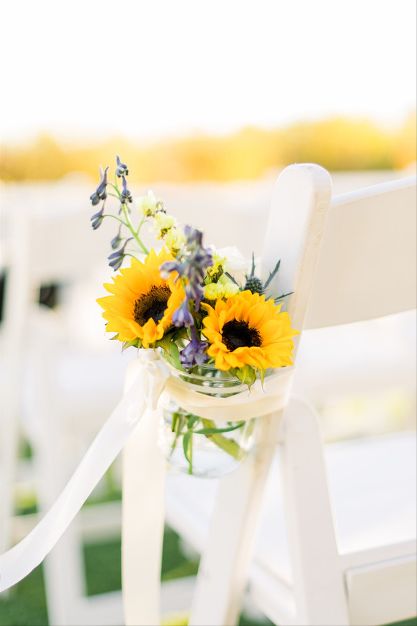 sunflower wedding aisle markers in mason jars with delphinium