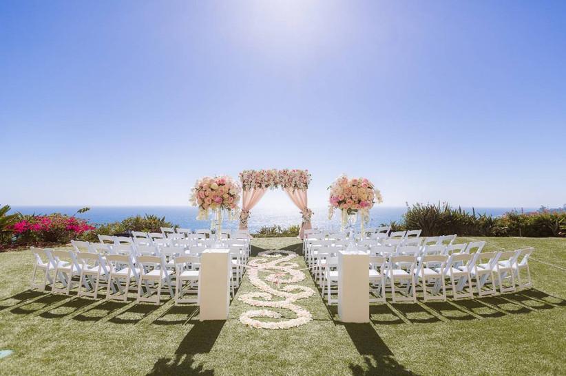 outdoor wedding ceremony with ocean backdrop