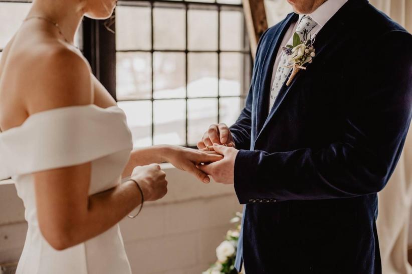 couple exchanging wedding rings