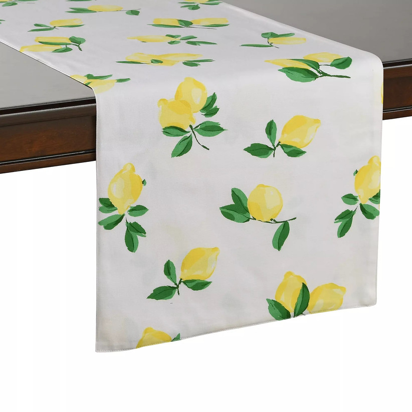 White tablecloth draped over table with lemon pattern