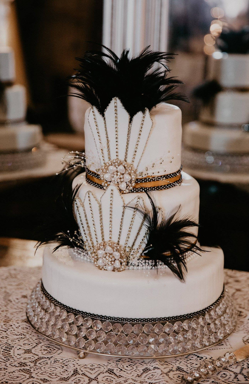 great gatsby wedding theme cake with white fondant and black feathers