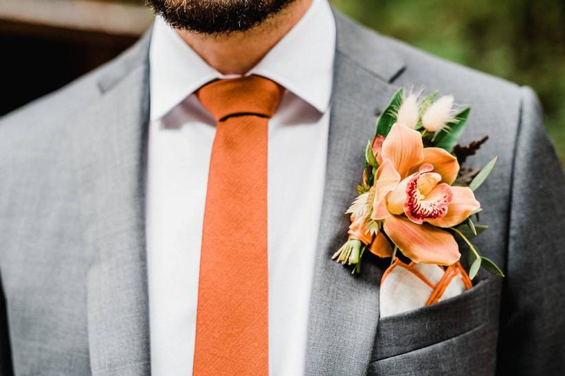 orange cymbidium orchid with gray suit