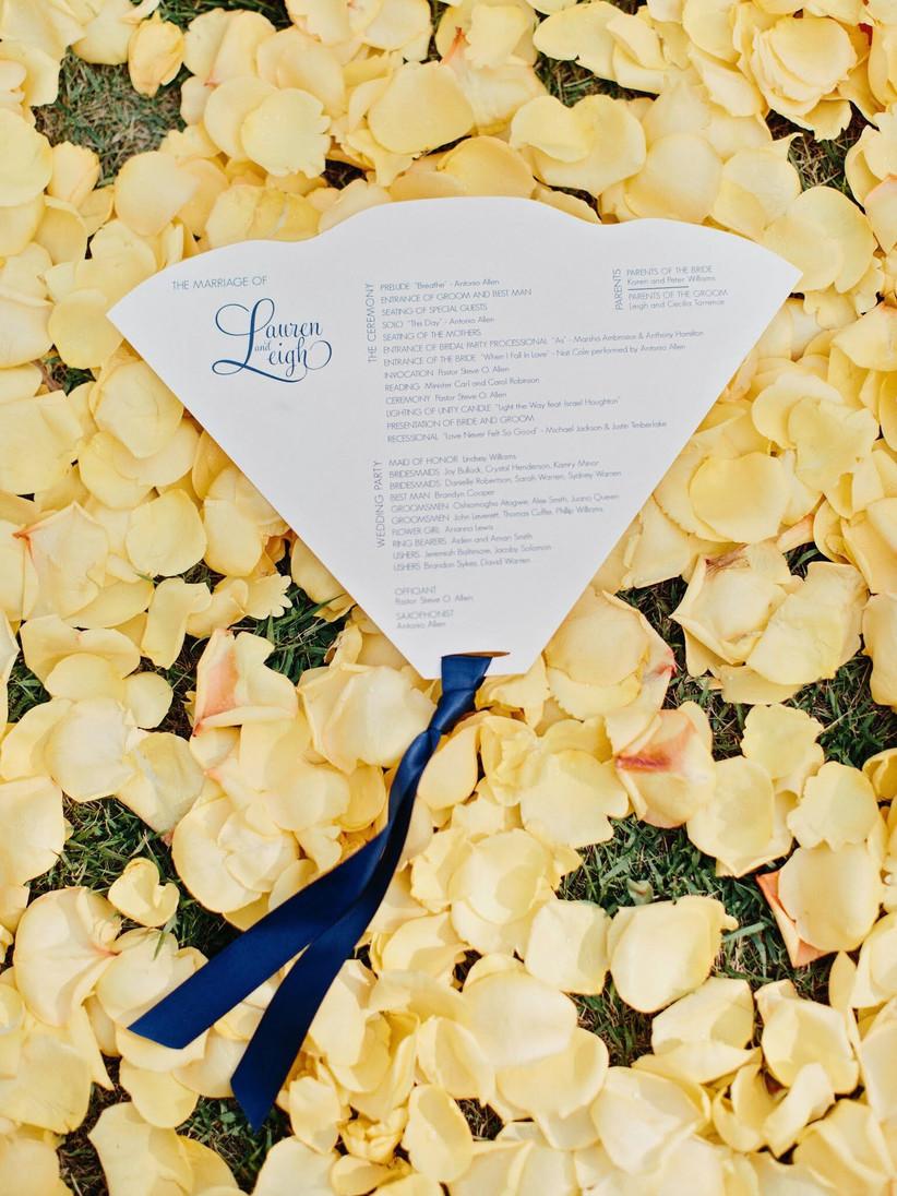 die-cut fan wedding ceremony program with navy blue ribbon at bottom