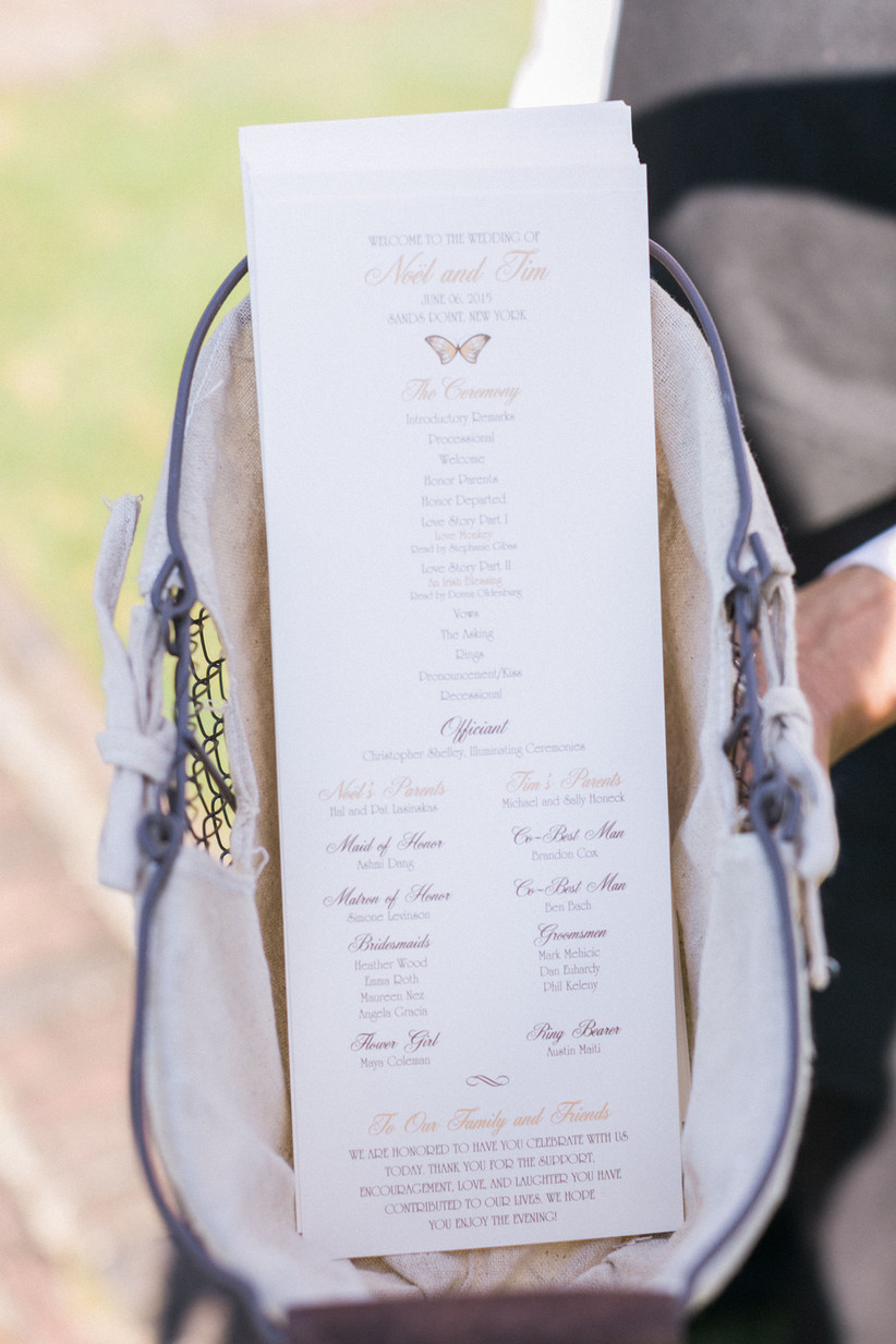 classic wedding ceremony program card displayed in a fabric basket