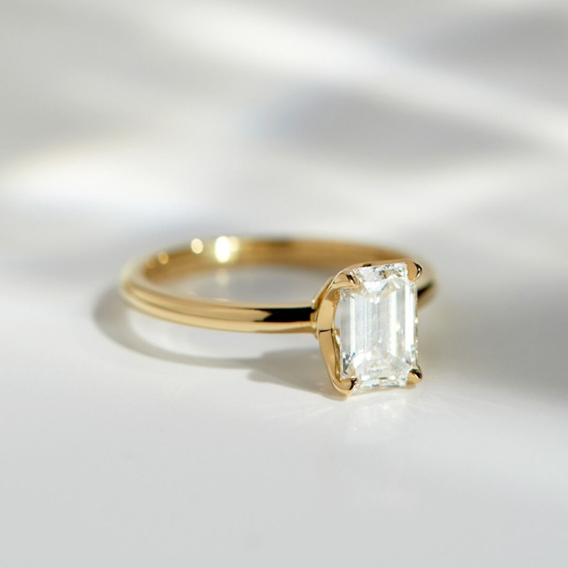 Antique minimalist Art Deco diamond engagement ring with yellow gold band