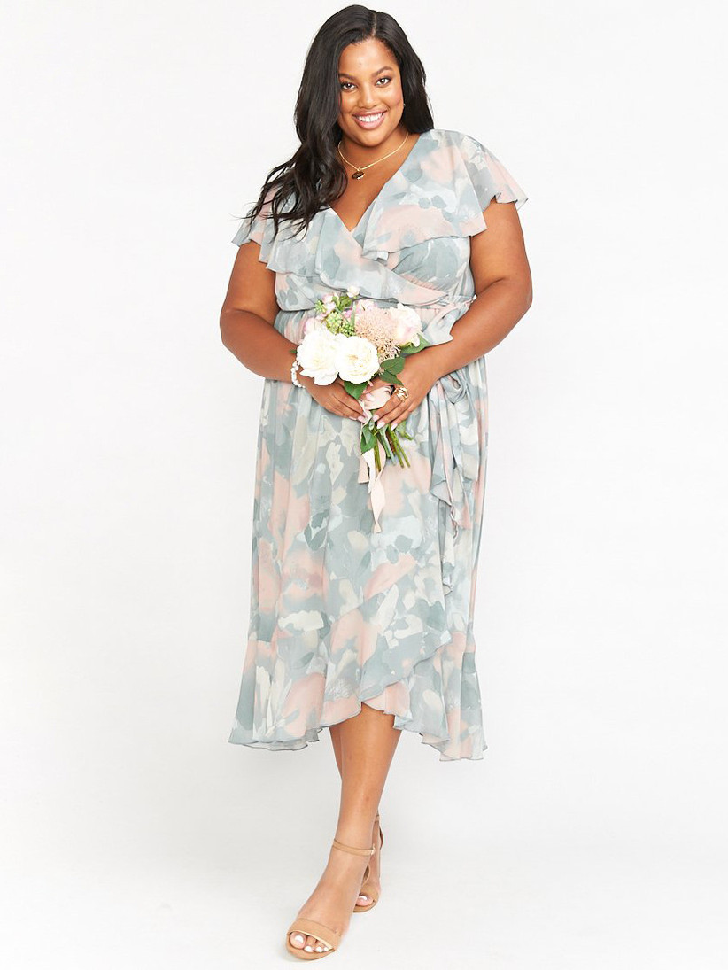 Model wearing floral midi dress with various pastel hues