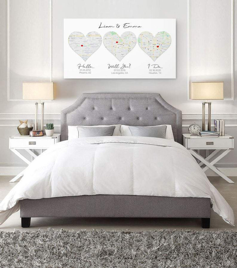 Romantic canvas map art of where the couple met, got engaged, and got married on display in couple's bedroom