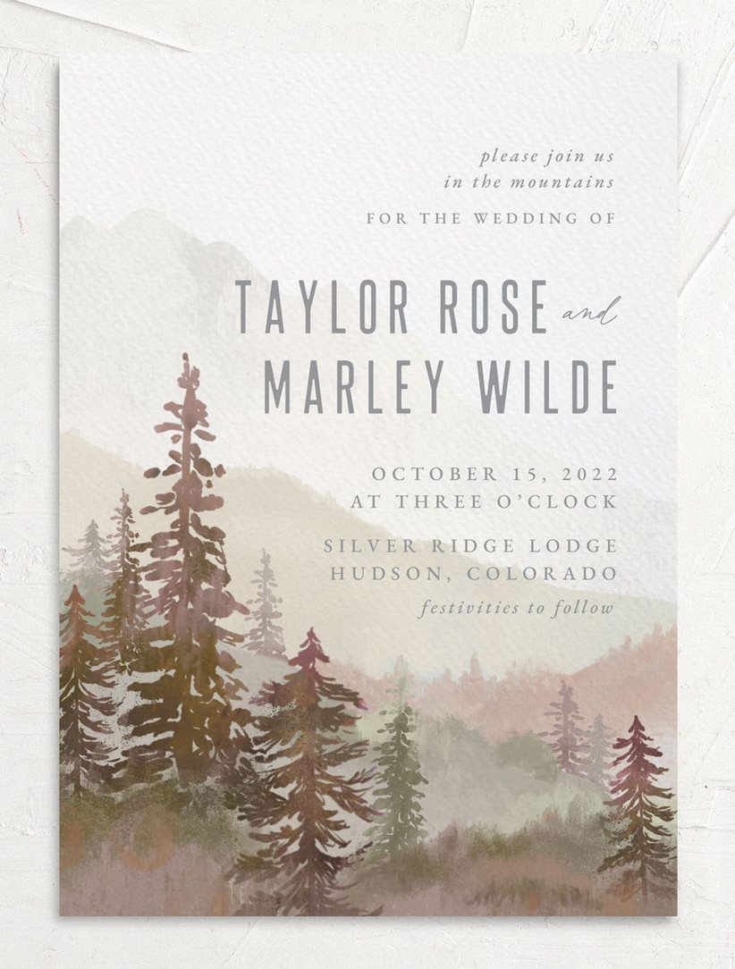 rustic fall wedding invitation with watercolor forest and mountain scene in brown and green color scheme