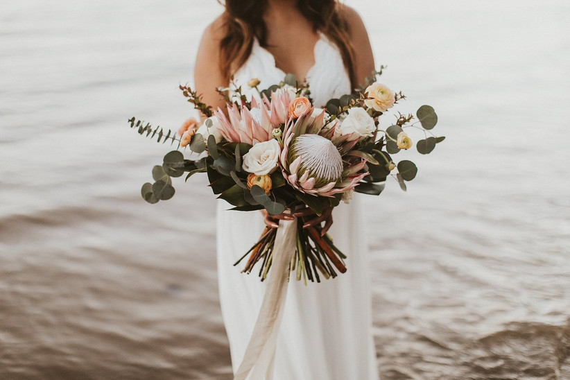 boho beach wedding bouquet with large pink king proteas and eucalyptus