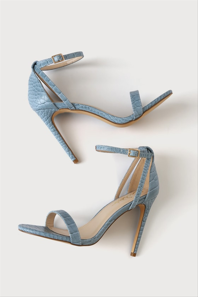 blue stiletto sandals with faux crocodile pattern