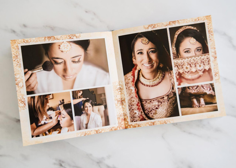 Layflat wedding photo book lying open showing collage of bride getting ready