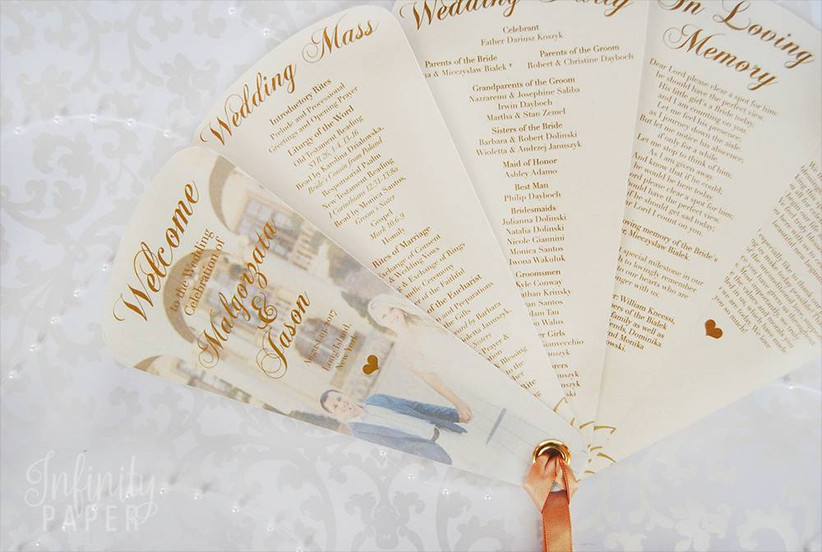 paper fan wedding ceremony program tied together with satin ribbon