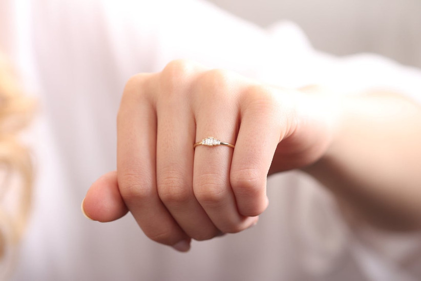 Dainty baguette diamond engagement ring