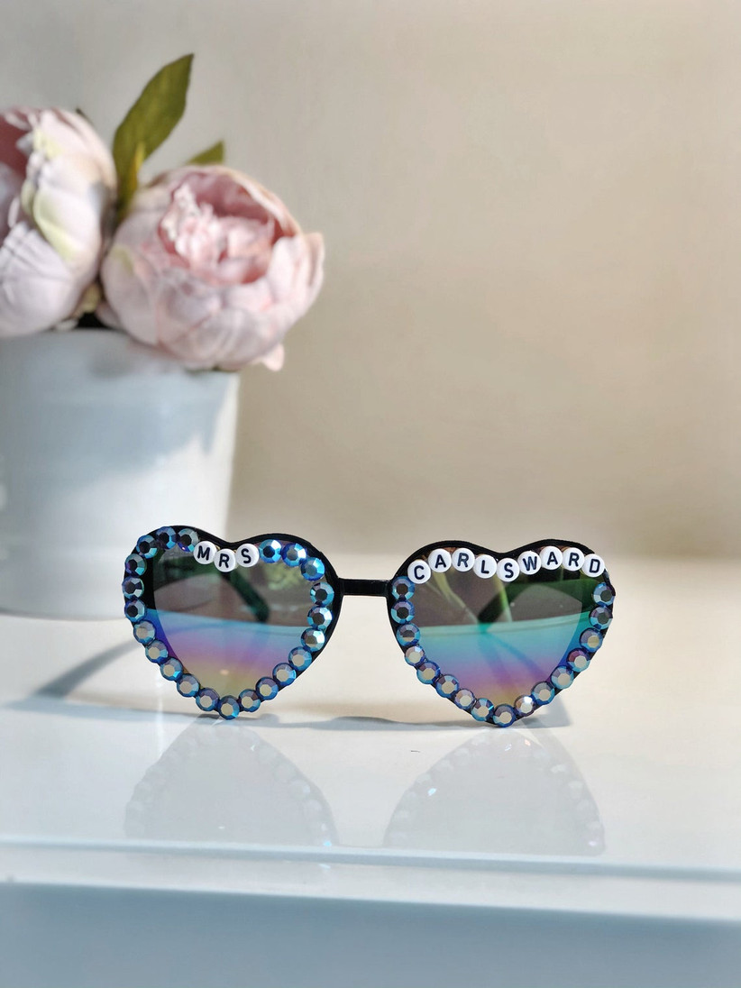 heart-shaped sunglasses decorated with letter beads that read mrs. carlsward