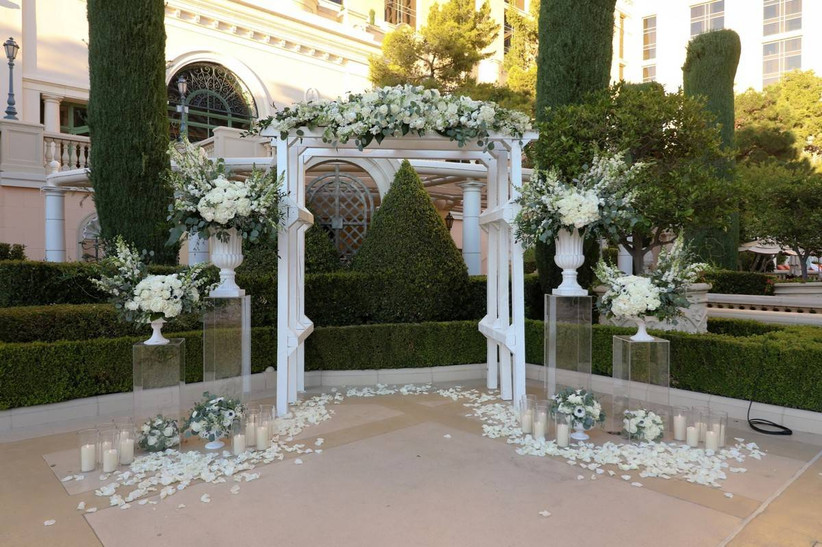outdoor las vegas wedding chapel at bellagio hotel with landscaped gardens in the background
