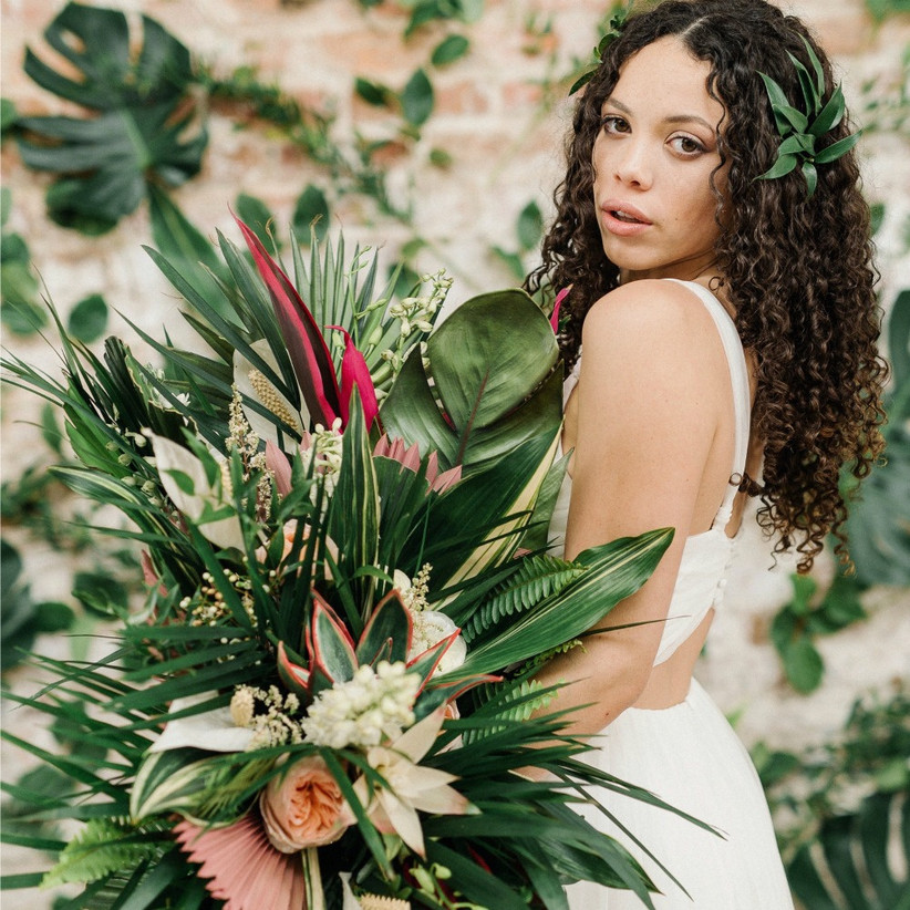modern tropical beach wedding bouquet with oversized greenery and palm fronds