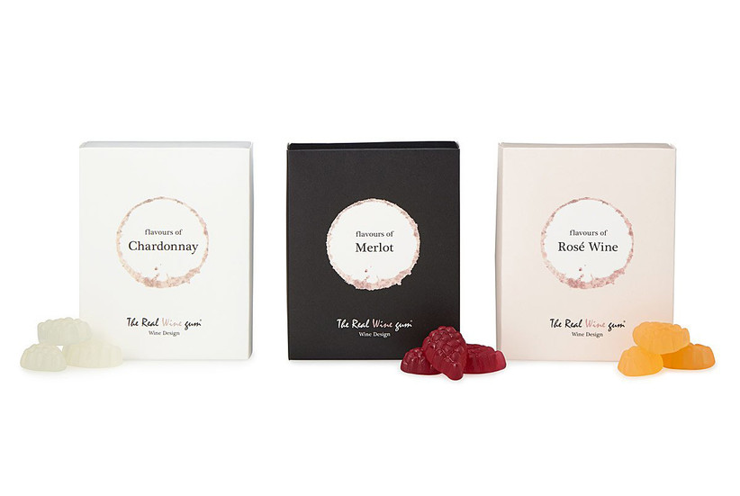 Three boxes of different wine-flavored gummies from left to right: chardonnay, merlot, rosé