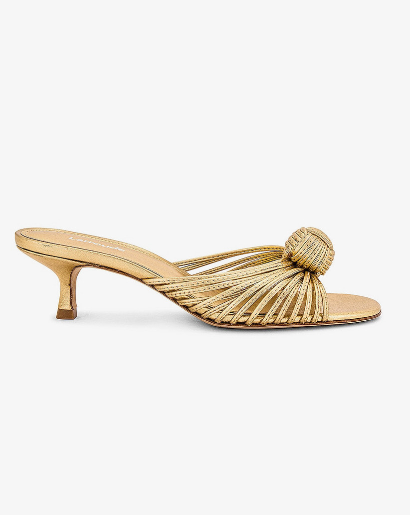 gold slip-on sandal with kitten heel and knotted detail at toe