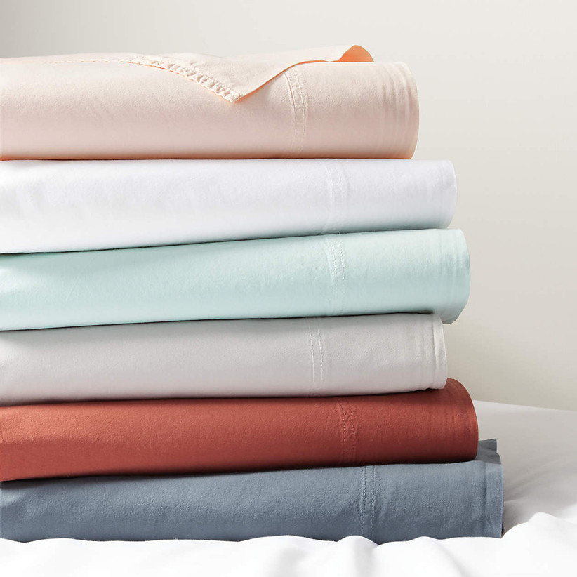 a stack of folder bed sheets in a variety of colors