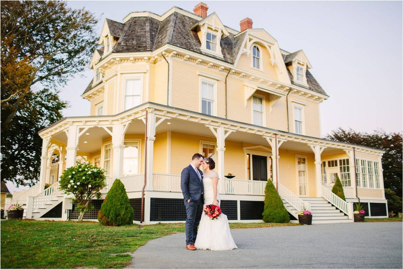 bride and groom outside historic home