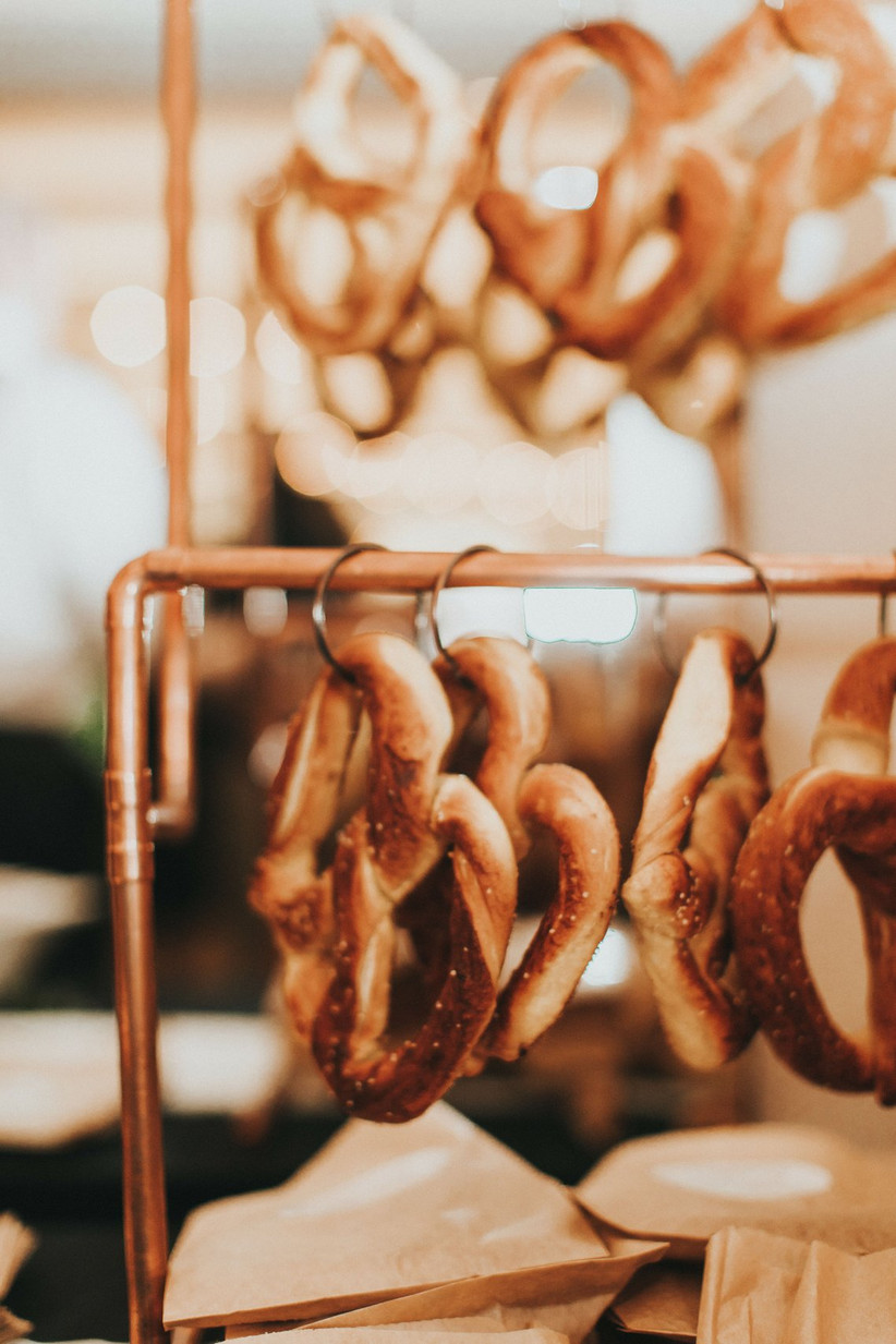 soft pretzels hanging from metal rack