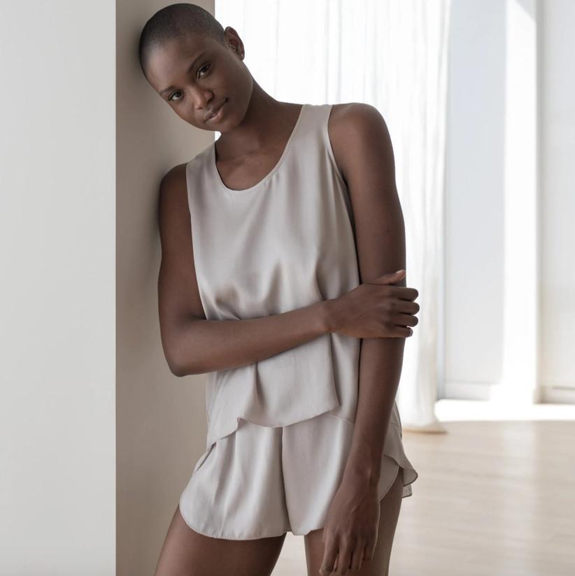 Woman wearing luxury washable silk pajama short and tank set