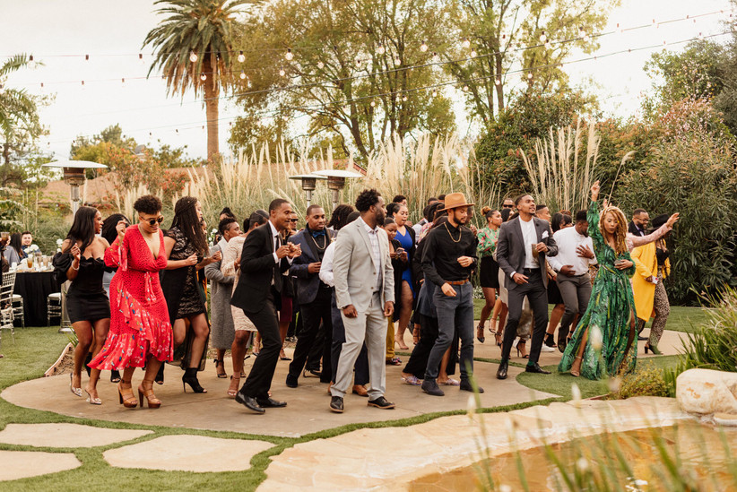 Guests gather on the dance floor at outdoor wedding venue