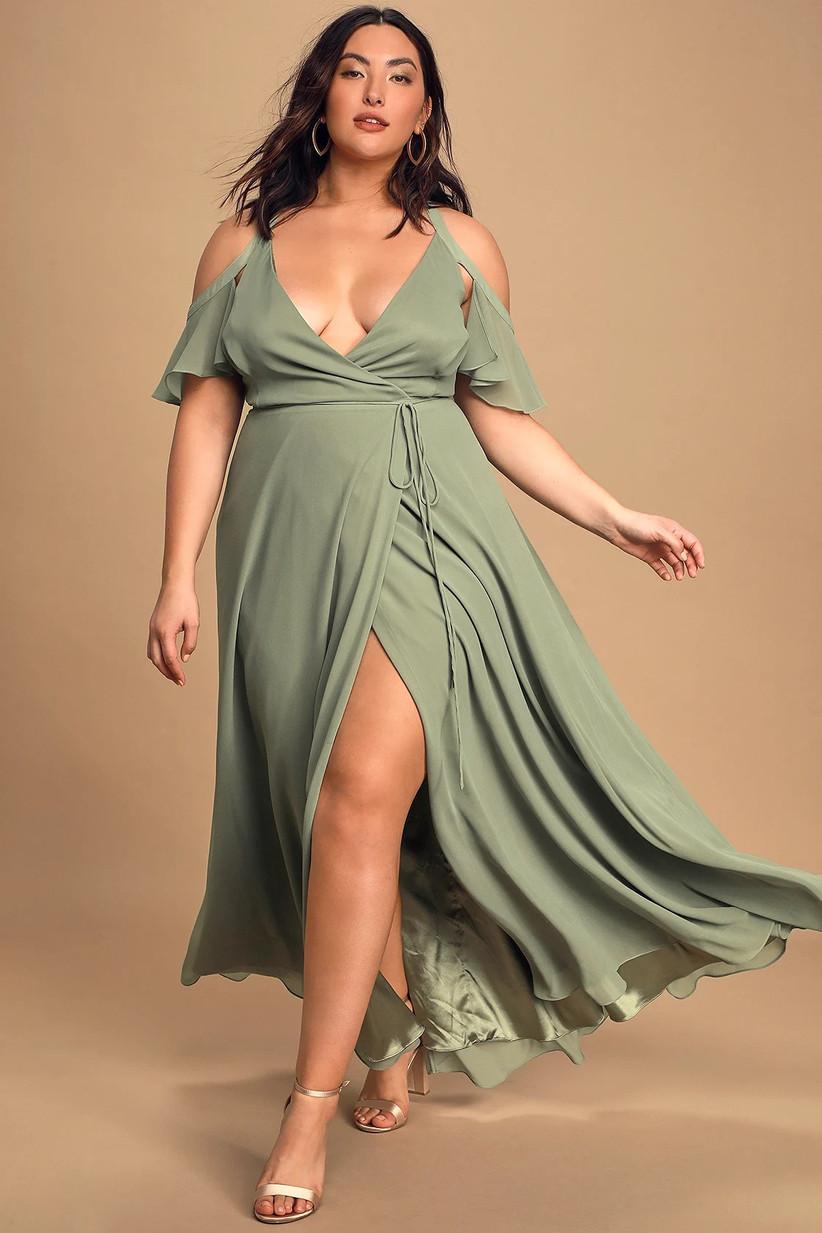 Model wearing cold-shoulder pastel green bridesmaid dress with deep V neckline and leg slit