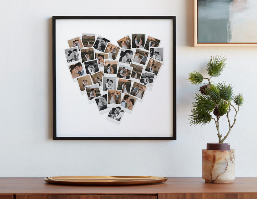 Heart-shaped photo collage gift on white background in black frame