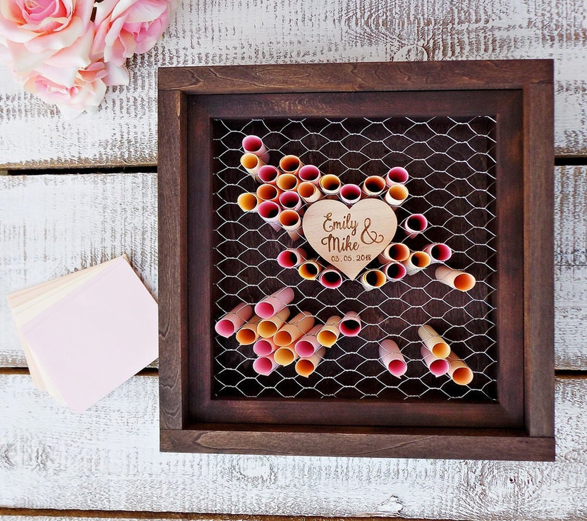 Wooden frame and paper scrolls unique wedding guest book idea
