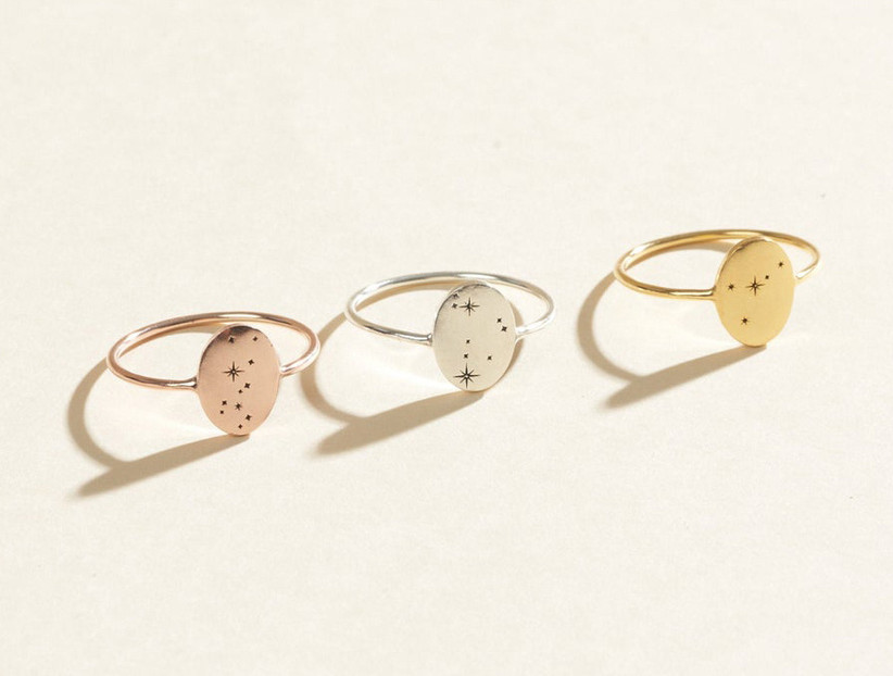 Three pretty constellation rings in different metallic shades