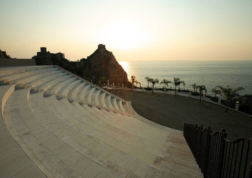 outdoor amphitheater overlooking the ocean at italy wedding venue in sicily