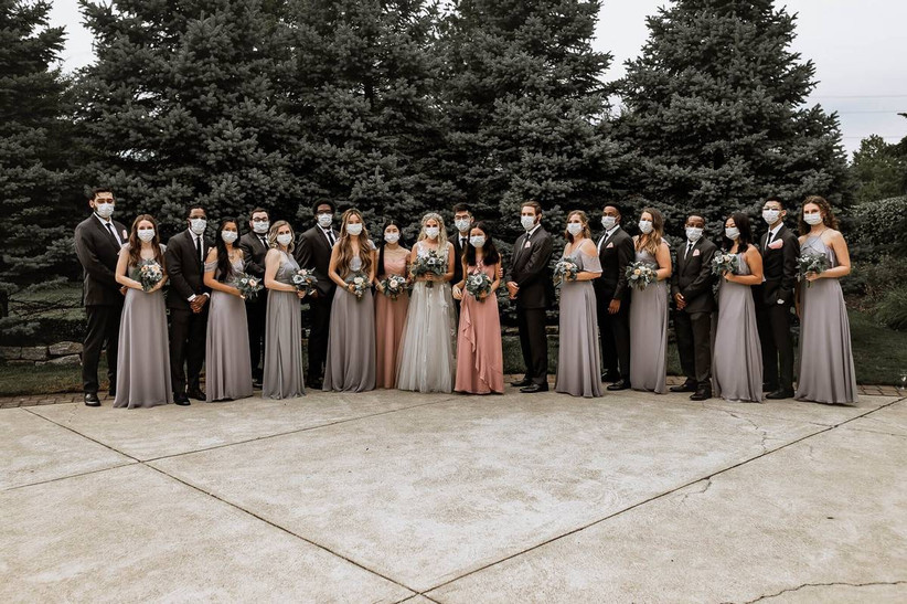 wedding party lined up wearing face masks