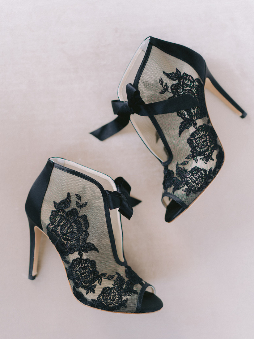 open-toe stiletto booties with sheer black lace and satin bows