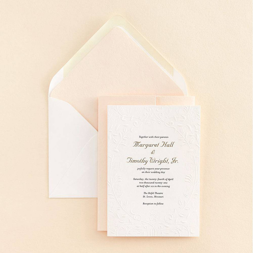 formal spring wedding invitation with white embossed floral pattern