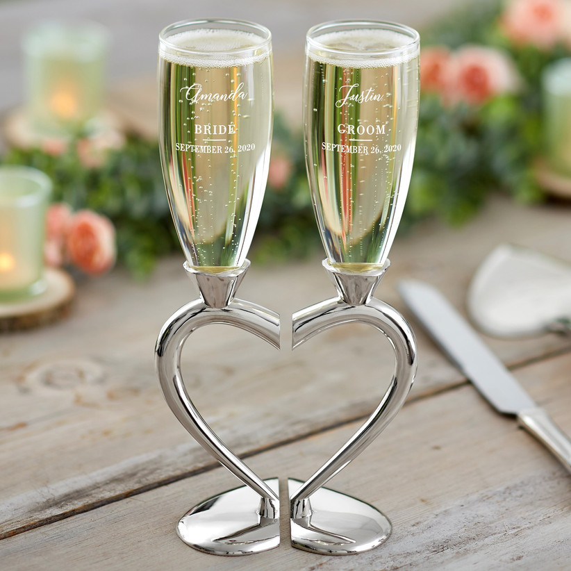 Bride and Groom wedding champagne flutes on silver heart stand