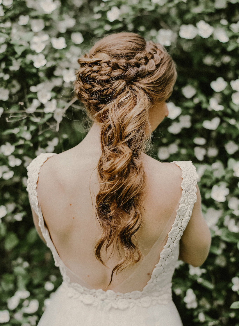 Wedding hairstyle for long hair crown braid with ends loose and curly