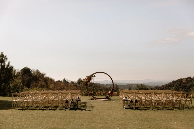 outdoor wedding ceremony with modern circle altar